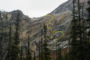 Yellow: Route up the rock ledge and moraine. Arrow points to triangular landmark